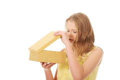 Young woman opening gift box Royalty Free Stock Image