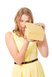 Young woman opening gift box Royalty Free Stock Photo