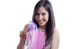 Young woman opening a gift Royalty Free Stock Photography