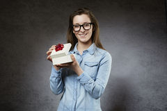 Young woman opening gift. Isolated Royalty Free Stock Images