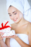 Young woman opening a heart-shaped gift box Royalty Free Stock Photography