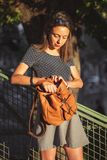 Young woman opening her backpack stock photos