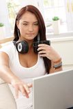 Young woman opening laptop screen Royalty Free Stock Photography