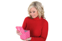 Young Woman Opening a Pink Gift Box. Stock Photos