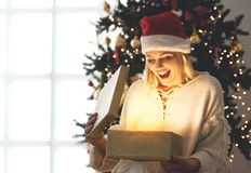 Young woman opening a present on Christmas morning Royalty Free Stock Photo