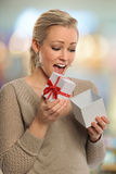 Young Woman Opening Present Stock Photography