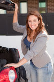 Young Woman opening the trunk Stock Photos