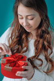 Young woman opens a gift Stock Photos