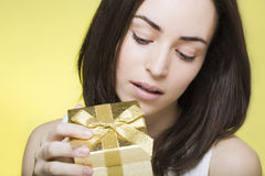 Young woman opens a gift box Stock Photos