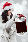 Young woman opens a gift box Royalty Free Stock Photos