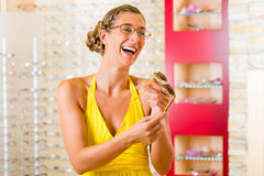 Young woman at optician with glasses Royalty Free Stock Images