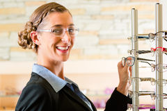 Young woman at optician with glasses Royalty Free Stock Photography