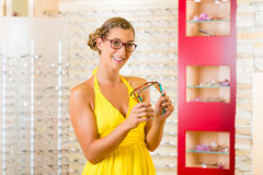 Young woman at optician with glasses Royalty Free Stock Photos