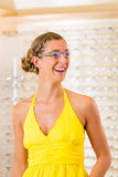 Young woman at optician with glasses Stock Photography
