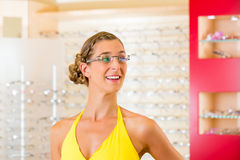 Young woman at optician with glasses Royalty Free Stock Image