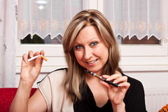 Young woman opts for electronic cigarette Stock Photos