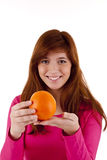 Young woman with orange Royalty Free Stock Photos