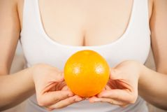 A young woman with an orange Stock Images