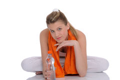 Young woman with orange fitness towel Stock Images