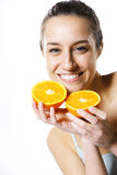 Young woman with orange half Stock Photos