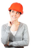 Young woman with orange hard hat on white Stock Photos