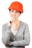 Young woman with orange hard hat on white Royalty Free Stock Images