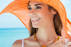 Young Woman With Orange Hat At The Sea Royalty Free Stock Photos