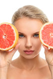 Young woman with orange in her Stock Image