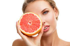 Young woman with orange in her Royalty Free Stock Photo
