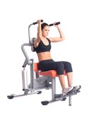 Young woman on orange  hydraulic exerciser Royalty Free Stock Image
