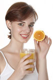 Young woman and orange juice Stock Photos