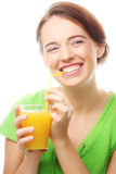 Young woman with orange juice Royalty Free Stock Photos