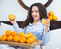 Young woman with orange juice and fruits Royalty Free Stock Photography
