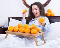 Young woman with orange juice and fruits Royalty Free Stock Images