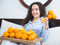 Young woman with orange juice and fruits Royalty Free Stock Photos