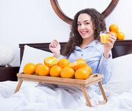 Young woman with orange juice and fruits Stock Photo