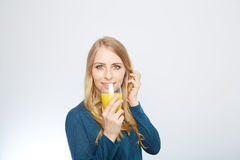 Young woman with orange juice, isolated on white Stock Images