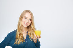 Young woman with orange juice, isolated on white Royalty Free Stock Image