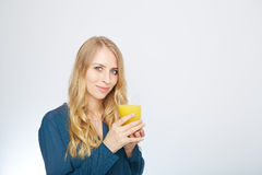 Young woman with orange juice, isolated on white Stock Photography