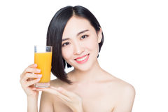 Young woman with orange juice Stock Images