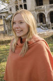 Young woman in orange poncho Royalty Free Stock Images