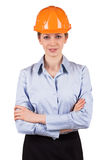 Woman in an orange protective helmet Royalty Free Stock Photos