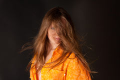 Young woman in orange shirt Stock Photos
