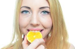 Young woman with orange slice Royalty Free Stock Photography
