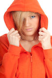 Young woman in orange sweatshirt Stock Image