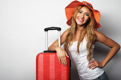 Young woman  with orange travel bag Royalty Free Stock Images