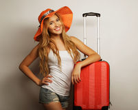 Young woman  with orange travel bag Royalty Free Stock Photo