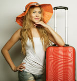 Young woman  with orange travel bag Royalty Free Stock Photography