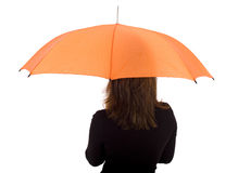 Young woman with orange umbrella Royalty Free Stock Photo