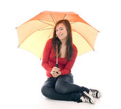 Young woman with orange umbrella Royalty Free Stock Photos